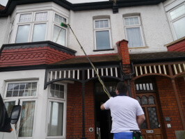 Professional window cleaner on a job
